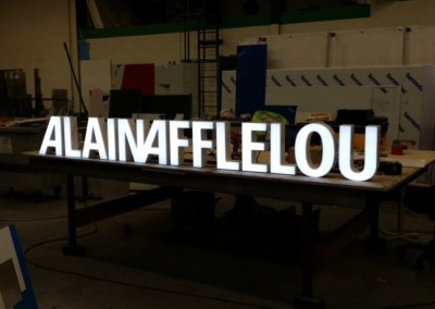 Vos enseignes à Lyon: Enseigne lumineuse avec lettres en relief pour Alain Afflelou par SES Grigny-Lyon