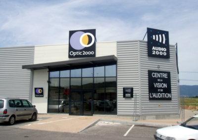 Enseigne par SES à Grigny ( Lyon) Panneau aluminium pour Optic 2000 (Passins)