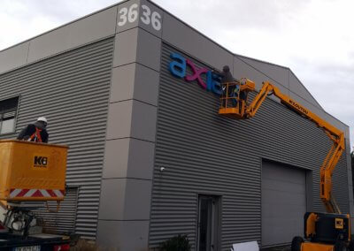 Installation enseignes Axians Lyon -SES Lyon Grigny- Enseigniste